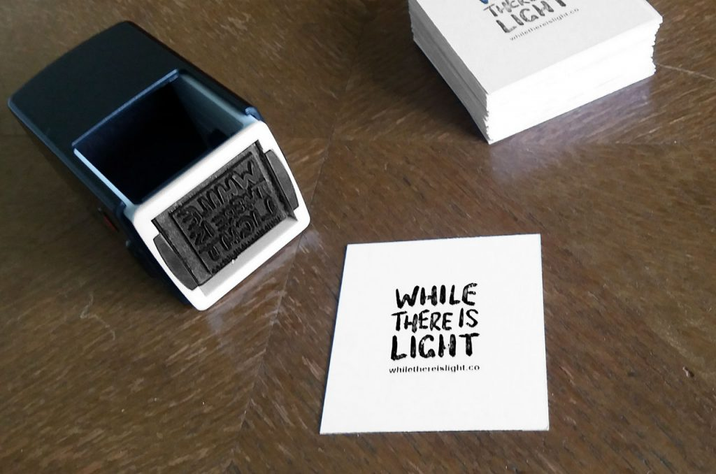 while there is light logo branding rubber stamp and business card
